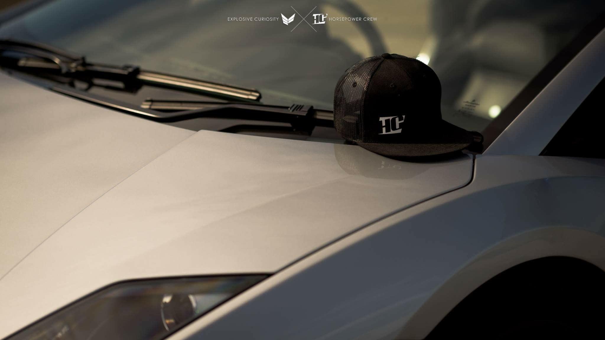 Hat-black-with-white-HC-on-lambo-angle