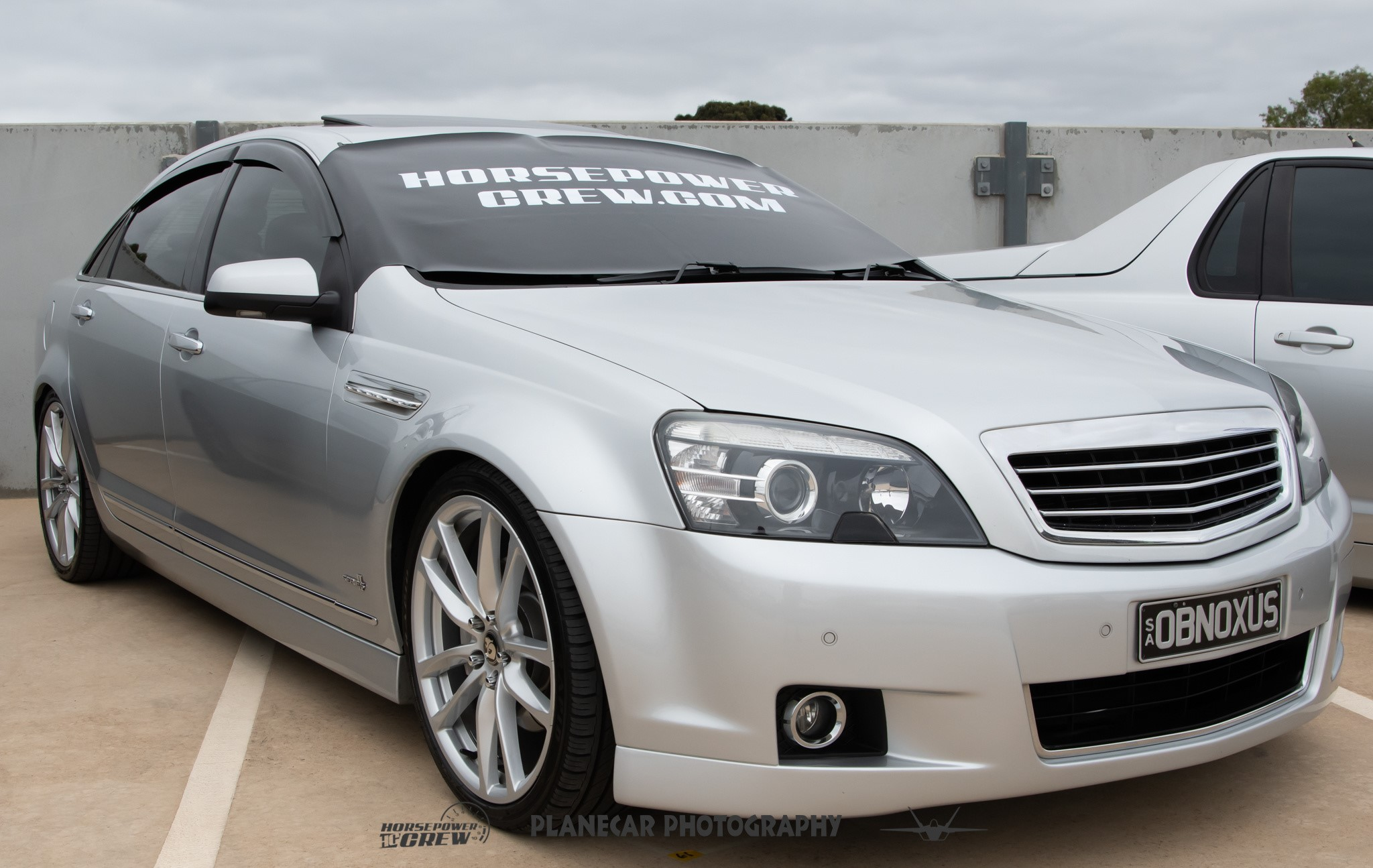 windscreen-cover-dot-com-modern-size-black-with-white-writing-silver-Holden